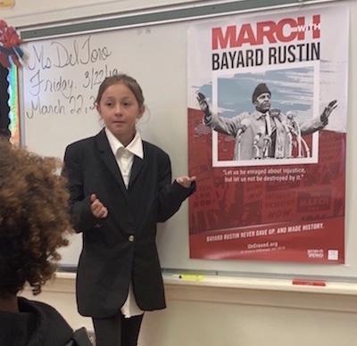 Student introducing Bayard Rustin to classmates