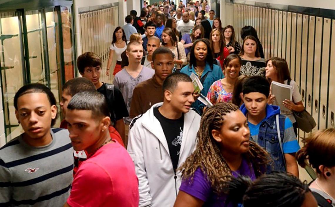 diverse high school students in hallway between classes